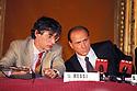 Umberto Bossi, President of Lega Nord (political party) speaks with Silvio Berlusconi, President af Forza Italia, at a common press conference with Pier Ferdinando Casini, Secretary of new party Centro Cristiano Democratico, Milan, February 5, 1994. © Carlo Cerchioli
