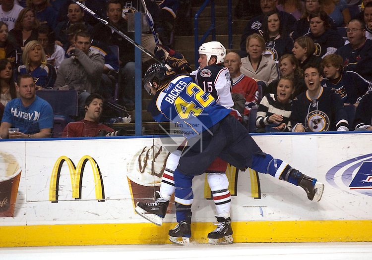 April 10 2009       Blues player David Backes (42) smashes Blue Jackets player Derek Dorsett (15) into the boards in the second period.   The St. Louis Blues hosted the Columbus Blue Jackets in the final regular season home game for the Blues at the Scottrade Center in downtown St. LOuis, MO.  ..            *******EDITORIAL USE ONLY*******