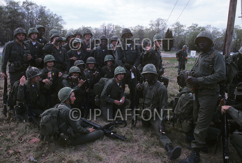 Fort Dix, NJ, USA, June 1980. US Army military training. A group of recruits having a break.