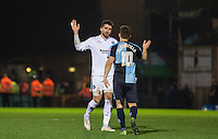 Goalkeeper Matt Ingram of Wycombe Wanderers & Matt Bloomfield of Wycombe Wanderers celebrate victory during the Sky Bet League 2 match between Wycombe Wanderers and Oxford United at Adams Park, High Wycombe, England on 19 December 2015. Photo by Andy Rowland.