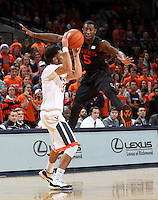 Virginia guard London Perrantes (32) is defended by Miami guard Davon Reed (5) during the game Tuesday, Jan. 12, 2016 in Charlottesville, Va. Virginia defeated Miami 66-58. Photo/Andrew Shurtleff