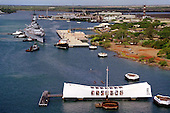 Tug boats push the battleship USS Missouri (BB 63) to its new berth at Ford Island, on June 22, 1998, as it joins the USS Arizona Memorial (foreground) in Pearl Harbor, Hawaii.  United States Secretary of the Navy John H. Dalton signed the Donation Agreement on May 4th, allowing Missouri to be used as a museum near the Arizona Memorial as symbols of the beginning and the end of World War II.  The Missouri was towed 2,600-miles across the Pacific Ocean from Bremerton, Washington.           <br /> Mandatory Credit: Kerry E. Baker / U.S. Navy via CNP