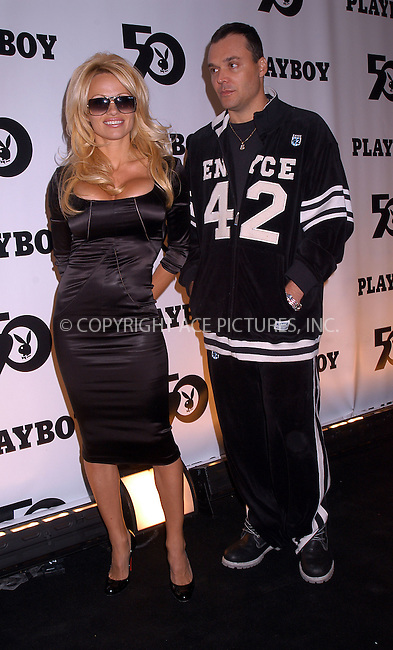 Pamela Anderson and David LaChapelle attend Playboy's 50th Anniversary Party in New York. December 4, 2003. ..Please byline: AJ SOKLANER/NY Photo Press.   ..*PAY-PER-USE*      ....NY Photo Press:  ..phone (646) 267-6913;   ..e-mail: info@nyphotopress.com