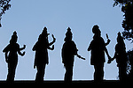 Silhouettes of statues are seen near the entrance to the caves at Batu Caves on Wednesday April 24th 2013 in Kuala Lumpur, Malaysia. (Photo by Brian Garfinkel)