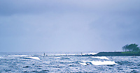 Local fishermen are throw net fishing (called 'upena kiloi) off the reef on the southeastern Puna side of the island of Hawai'i.