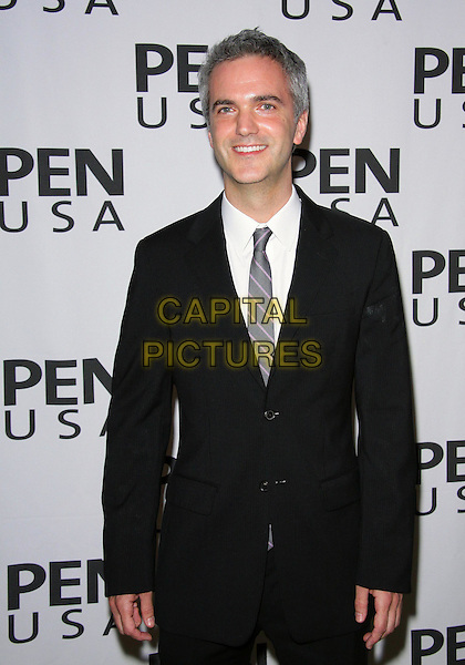 Guest .20TH Annual Literary Awards Festival held at the Beverly Hills Hotel, Beverly Hills, CA, USA, .17th November 2010..half length black suit white shirt tie .CAP/ADM/TC.©T. Conrad/AdMedia/Capital Pictures.