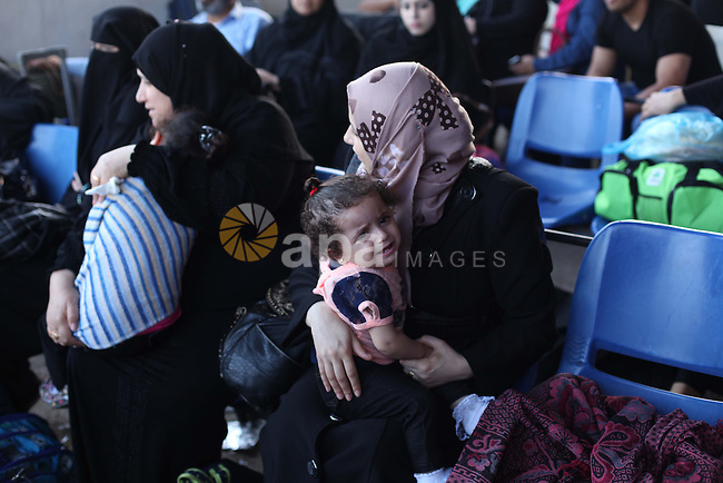 Palestinians wait for travel permits to cross into Egypt at the Rafah border crossing between Egypt and southern Gaza Strip June 15, 2015. Egypt opened the Rafah border crossing on Saturday to allow Palestinians to travel in and out of the Gaza Strip for the first time in three months, in a possible sign of easing tension between Cairo and Gaza's dominant Islamist Hamas movement. Gaza, a small impoverished coastal enclave, is under blockade by neighbouring Israel, and Egypt has kept its Rafah crossing largely shut since Cairo's Islamist president was toppled by the army in 2013. Photo by Ashraf amra