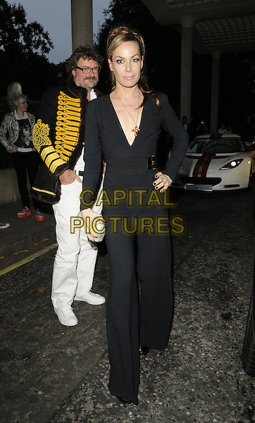 TARA PALMER-TOMKINSON.Freddie For A Day charity gala arrivals, Savoy hotel, the Strand, London, England..September 5th, 2011.full length black jumpsuit plunging neckline hand on hip tpt.CAP/CAN.©Can Nguyen/Capital Pictures.