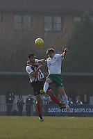 Pat Hoban of Grimsby Town is challenged by Doug Tuck of Bognor Regis Town during the FA Trophy Semi Final first leg match between Bognor Regis and Grimsby Town at Nyewood Lane, Bognor Regis, England on 12 March 2016. Photo by Paul Paxford/PRiME Media Images.