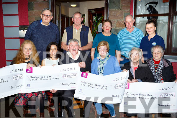 Brendan Ferris presented the proceed of the Beaufort Trashing  Cancer in Beaufort to the four charities in Galvins bar on Saturday night front row l-r: Ann Enright Kerry Hospice, Theresa Walsh Oncology Unit Tralee, Maureen O'Brien Recovery Haven and Sr Helena St Josephs Killorglin. Back row: Mike O'Shea, Tuddy Clifford, Kathleen Breen, Jim Clifford, and Jacqui Tangney