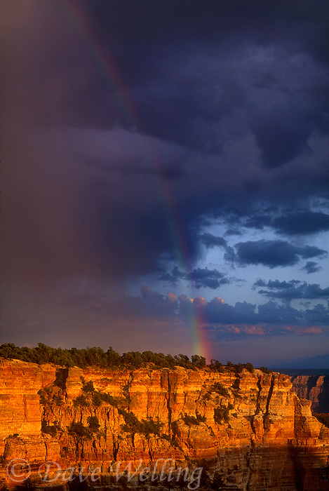 749220009 a rainbow forms after a clearing monsoon summer storm along cape royal on the north rim of grand canyon national park in arizona