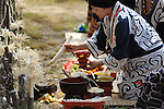 Ainu woman in a traditional ritual during the Chipusanke Ainu festival in Nibutani. Hokkaido. Japan.