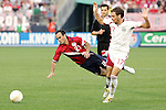 28 May 2006: U.S. midfielder Landon Donovan (21) goes down as Latvia's Oskars Klava (17) claims innocence. The United States Men's National Team defeated Latvia 1-0 at Rentschler Field in East Hartfort, Connecticut in an international friendly soccer match.