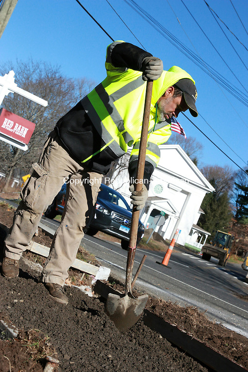WOODBURY, CT: 23 Nov. 2015: 231115CBO1: WOODBURY -- Rui Paz, with Complete Construction, works to lengthen a sidewalk on Main Street, part of a project to move a pedestrian crosswalk. The current crosswalk location, near the intersection of Main Street and Judson Avenue, is considered unsafe by officials. Public Works Director Rich Lamothe said the project's contractor expects work to be completed within a few weeks. Caleb Bedillion Republican-American