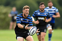 Rhys Priestland of Bath Rugby passes the ball against the visiting Dragons team. Bath Rugby pre-season training on August 8, 2018 at Farleigh House in Bath, England. Photo by: Patrick Khachfe / Onside Images