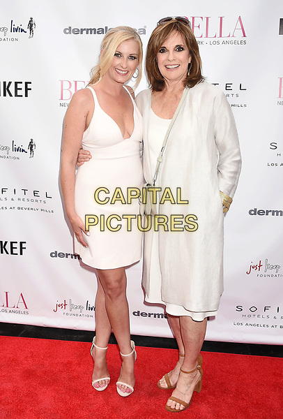 LOS ANGELES, CA - JUNE 23:  BELLA CEO &amp; Founder Courtenay Hall (L) and actress Linda Gray attend the BELLA Los Angeles Summer Issue Cover Launch Party at Sofitel Los Angeles At Beverly Hills on June 23, 2017 in Los Angeles, California.<br /> CAP/ROT/TM<br /> &copy;TM/ROT/Capital Pictures