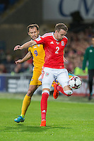 Chris Gunter of Wales protects the ball from Eugeniu Cebotaru of Moldova during the FIFA World Cup Qualifier match between Wales and Moldova at Cardiff City Stadium, Cardiff, Wales on 5 September 2016. Photo by Mark  Hawkins.