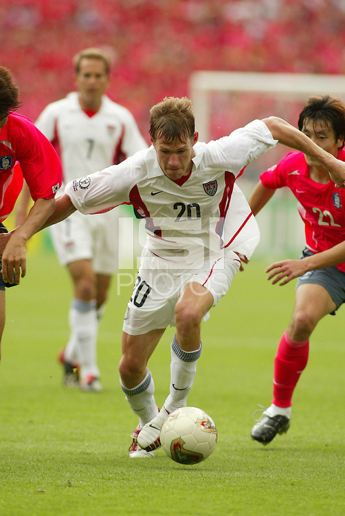 Brian McBride tries to turn upfield. The USA tied South Korea, 1-1, during the FIFA World Cup 2002 in Daegu, Korea.