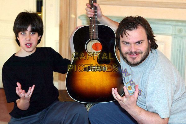JOEY GAYDOS & JACK BLACK.School Of Rock photocall in Rome.12 February 2004.funny face, playing guitar.www.capitalpictures.com.sales@capitalpictures.com.© Capital Pictures.