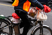 NEW YORK, NY - APRIL 2: A delivery carries and uses plastic bags on his bike on April 2, 2019 in New York. New York will become the second state in U.S. to ban shops from providing single-use plastic bags for most purchases.   (Photo by Eduardo MunozAlvarez/VIEWpress)