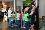 Oakland CA Second grade students and parent chaperones awaiting entry to exhibits at Chabot Space and Science Center on school field trip