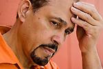 Mature hispanic man looking pensive