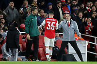 Arsenal Head Coach, Unai Emery holds out his hand to Gabriel Martinelli after being substituted in the second half during Arsenal vs Eintracht Frankfurt, UEFA Europa League Football at the Emirates Stadium on 28th November 2019