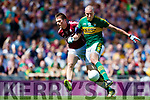 Kieran Donaghy Kerry shoots to score his side's only goal despite the attention of Liam Silke Galway in the All Ireland Senior Football Quarter Final at Croke Park on Sunday.