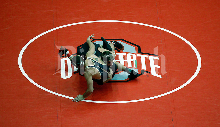 Ohio State's Hunter Stieber, top, takes down Purdue's Brandon Nelson, bottom,  during his opening match in the 149 lb class at the 2015 Big Ten Wrestling Championship at St. John Arena in Columbus, Ohio on March 7, 2015.  Stieber  won the match.