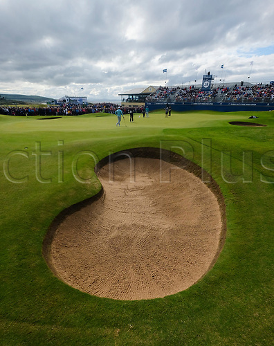 July 7th 2017, Portstewart Golf Club, Portstewart, Northern Ireland; Dubai Duty Free Irish Open Golf Championship, Day 2; Justin Rose (ENG) and Tommy Fleetwood (ENG) on the 18th green in front of the main stand during the second round of the Dubai Duty Free Irish Open