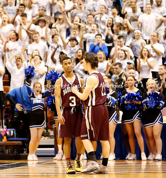 Uncasville, CT- 22 March 2015-032215CM12- Naugatuck's Charles Wall (3) and Jason Bradley console each other during the final moments of their Class L state championship game against Bunnell at Mohegan Sun Arena in Uncasville on Sunday.    Christopher Massa Republican-American