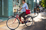 A man riding a bicycle in trendy Sakae, Nagoya.