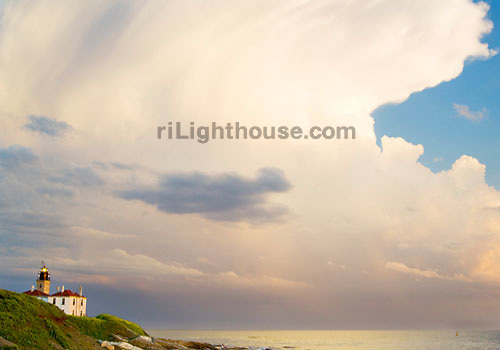 Clouds swirl in the sunset above the Beavertail Lighthouse.