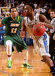 BROOKINGS, SD - FEBRUARY 14:  Deondre Parks #0 from South Dakota State drives past Lawrence Alexander #12 form North Dakota State in the first half of their game Saturday afternoon at Frost Arena. (Photo by Dave Eggen/Inertia)