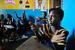 Children clap during class in a day care center in Monrovia, Liberia, sponsored by United Methodist Women.