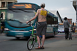 © Joel Goodman - 07973 332324 .  12/06/2015. Manchester, UK. A cyclist stands by fast-moving buses . Hundreds take part in the World Naked Bike Ride , which sees cyclists undress and cycle nude through Manchester City Centre . Photo credit : Joel Goodman