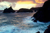 Waves crashing over the rocks at Kynance Cove in Cornwall, South West England.