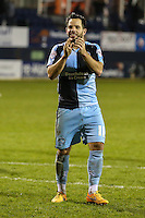 Sam Wood of Wycombe Wanderers applauds the travelling fans after the Sky Bet League 2 match between Luton Town and Wycombe Wanderers at Kenilworth Road, Luton, England on 26 December 2015. Photo by David Horn.