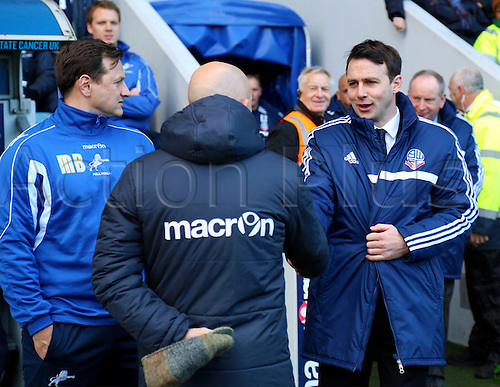 15.02.2014 London, England. Ian HOLLOWAY shakes hands with Dougie FREEDMAN during the Championship game between Millwall and Bolton Wanderers from The New Den.