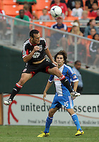 WASHINGTON, D.C. - AUGUST 19, 2012:  Hamdi Salihi (9) of DC United heads away from Gabriel Farfan (15) of the Philadelphia Union during an MLS match at RFK Stadium, in Washington DC, on August 19. The game ended in a 1-1 tie.