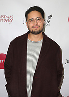 """LOS ANGELES, CA - NOVEMBER 7: Travis-Atreo, at Premiere of Lifetime's """"Christmas Harmony"""" at Harmony Gold Theatre in Los Angeles, California on November 7, 2018. Credit: Faye Sadou/MediaPunch"""