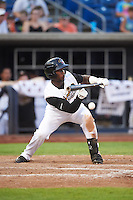 Quad Cities River Bandits designated hitter Hector Roa (15) lays down a bunt during a game against the Bowling Green Hot Rods on July 24, 2016 at Modern Woodmen Park in Davenport, Iowa.  Quad Cities defeated Bowling Green 6-5.  (Mike Janes/Four Seam Images)