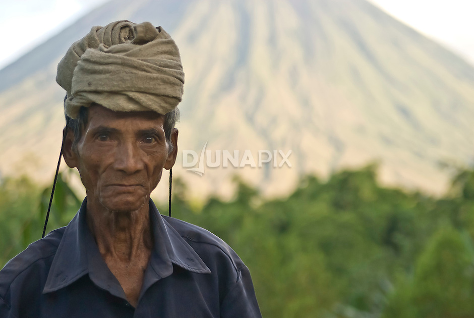 Old farmer portrait in front of Mount Inerie