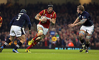 Luke Charteris of Wales (C) is brought down by Jonny Gray of Scotland (R) and Willem Nel (L) a team mate of his during the RBS 6 Nations Championship rugby game between Wales and Scotland at the Principality Stadium, Cardiff, Wales, UK Saturday 13 February 2016