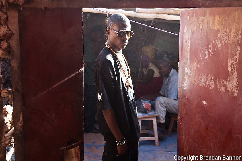 23-year-old hip-hop artist Octopizzo at the Victorious Youth group in Kibera. The youth group runs a small cooperative workshop making jewelry from cow bones in Kibera.