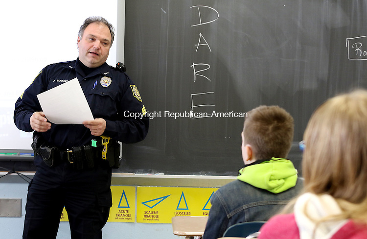 WINSTED CT. 11 January 2015-011116SV07-Sgt. Robert Varasconi explains about the DARE program to 6th graders at Pearson School in Winsted Monday. Winsted police are bringing back the DARE program to the elementary schools after eliminating it 4,5 years ago, likely due to budget cuts and manpower shortages. <br /> Steven Valenti Republican-American