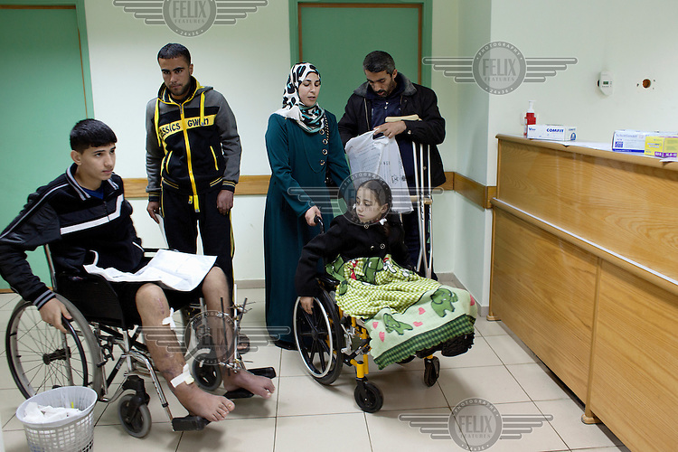 Weam Al Astal, a nine year old from Khan Younes, arrives at the Shifa hospital for a consultation regarding the serious injuries she received during the summer 2014 Israeli military operation ('Pillar of Defense') in the Gaza Strip. The operation lasted 51 days and resulted in 2,145 deaths and 11,231 injuries among the Palestinian population. The vast majority of the serious casualties have complex orthopaedic injuries that the Palestinian Ministry of Health is ill-equiped to manage. DFID/UK Aid is funding NHS Doctors, deployed through the UK's Rapid Response Facility's funding, to work alongside Medical Aid for Palestinians (MAP) in providing post conflict surgery at Gaza's Shifa Hospital. The NHS doctors (through the charity Ideals) volunteer to visit Gaza in their spare time and work alongside their Palestinian colleagues. <br /> <br /> Weam's mother says: 'She was sitting with her father and playing with her other cousins in the garden of their small home when a rocket hit them directly. She lost one leg. Four of her cousin's, all girls, were injured too, and her father he also lost a leg. Weam's injury is the worst. They were targeting children, they could see that there were children playing there.'