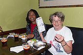 The Hyde Park Chamber of Commerce held its first annual Dinner Crawl of the year Tuesday evening. Participants were invited network, socialize and try food from various restaurants on 53rd street, 55th street and 57th street.<br /> <br /> 1567 &ndash; Vanessa Ellis and Stephanie Franklin enjoy crab rangoon, spring rolls and thai iced tea at Noodles Etc. located at 1333 E. 57th Street.<br /> <br /> Please 'Like' &quot;Spencer Bibbs Photography&quot; on Facebook.<br /> <br /> All rights to this photo are owned by Spencer Bibbs of Spencer Bibbs Photography and may only be used in any way shape or form, whole or in part with written permission by the owner of the photo, Spencer Bibbs.<br /> <br /> For all of your photography needs, please contact Spencer Bibbs at 773-895-4744. I can also be reached in the following ways:<br /> <br /> Website &ndash; www.spbdigitalconcepts.photoshelter.com<br /> <br /> Text - Text &ldquo;Spencer Bibbs&rdquo; to 72727<br /> <br /> Email &ndash; spencerbibbsphotography@yahoo.com