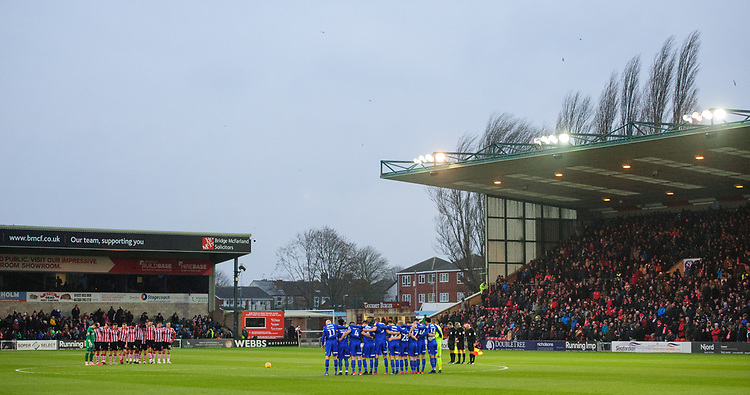 Lincoln City and Morecambe players during a minutes silence as mark of respect to Grace Millane, a former University of Lincoln pupil<br /> <br /> Photographer Chris Vaughan/CameraSport<br /> <br /> The EFL Sky Bet League Two - Saturday 15th December 2018 - Lincoln City v Morecambe - Sincil Bank - Lincoln<br /> <br /> World Copyright © 2018 CameraSport. All rights reserved. 43 Linden Ave. Countesthorpe. Leicester. England. LE8 5PG - Tel: +44 (0) 116 277 4147 - admin@camerasport.com - www.camerasport.com