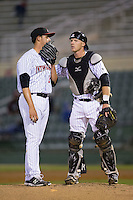 Kannapolis Intimidators catcher Casey Schroeder (10) has a chat on the mound with relief pitcher Yelmison Peralta (28) during the game against the Hickory Crawdads at Kannapolis Intimidators Stadium on April 9, 2016 in Kannapolis, North Carolina.  The Crawdads defeated the Intimidators 6-1 in 10 innings.  (Brian Westerholt/Four Seam Images)